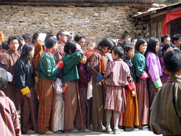 Villagers queue for blessing