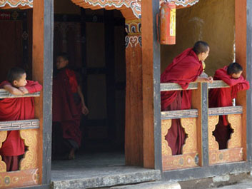Young monks look on