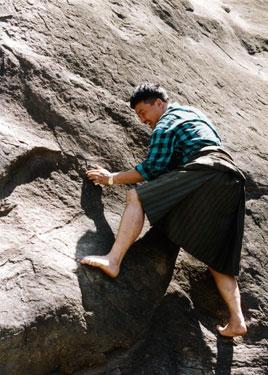 Karma tries to climb the black rock