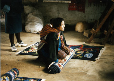Lady showing carpets