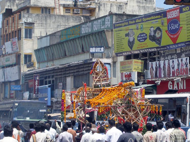Bedecked cart drawn through streets as part of festival
