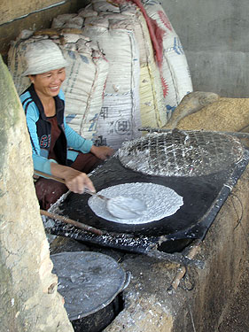 Lady making cassave wafers