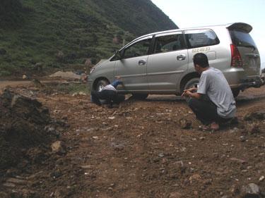 Car stuck on rock